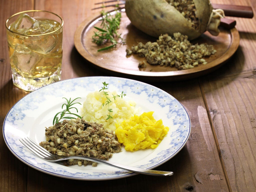 Haggis and sides on plate with drink