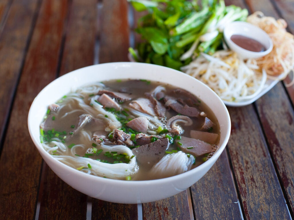 Khao pun with pork in bowl.