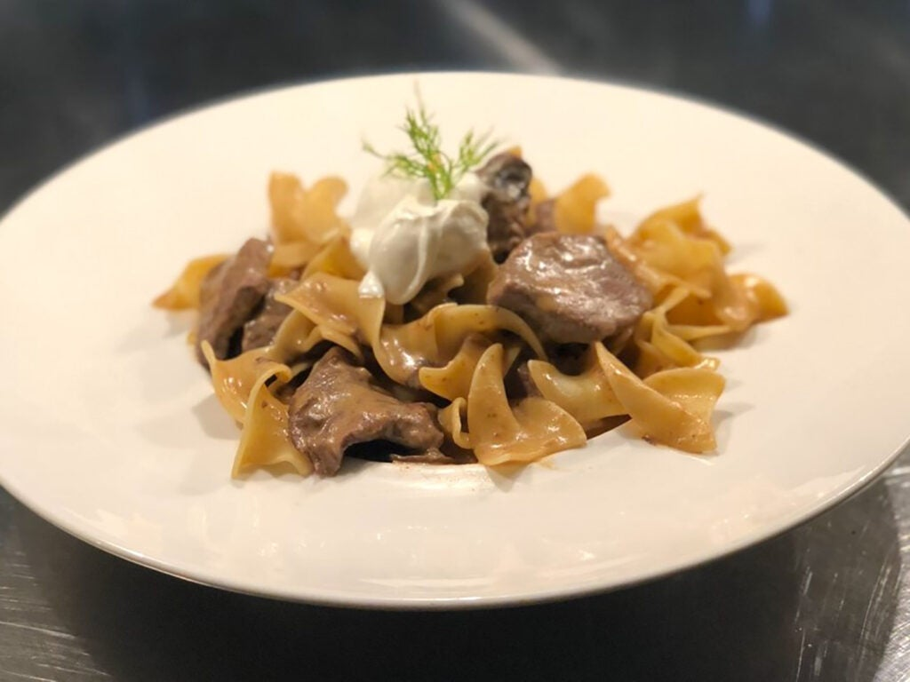 Egg noodles topped with meat in Point 57's stroganoff.