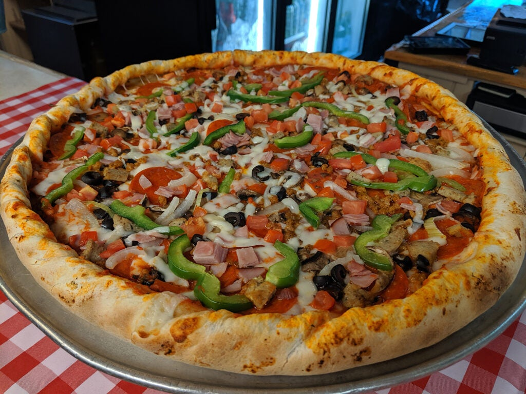 Veggies and meats on pizza at The Islander restaurant.