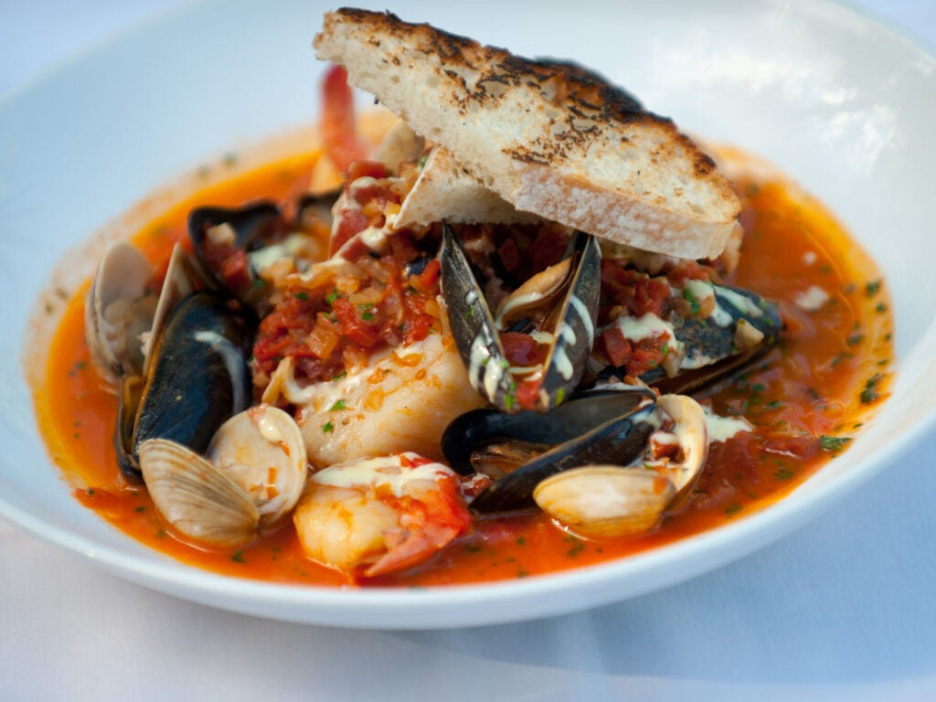 Mussels, shrimp and scallops in fish stew.