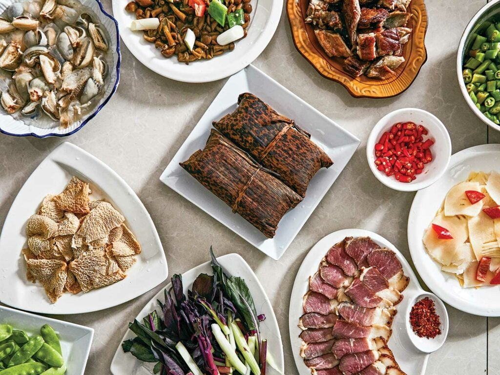 An array of dishes at Qicai Shanzhuang restaurant