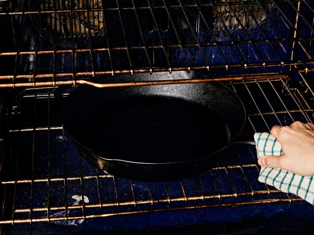 Preheating the oven and cast iron skillet.