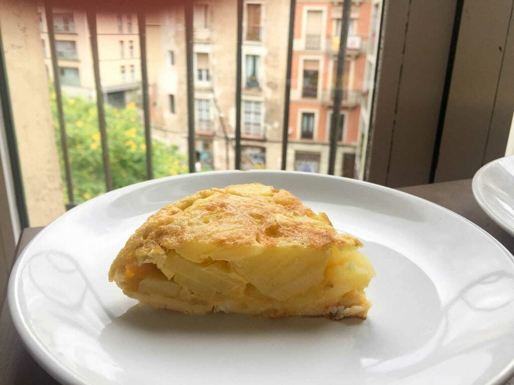 Spanish tortilla on white plate.