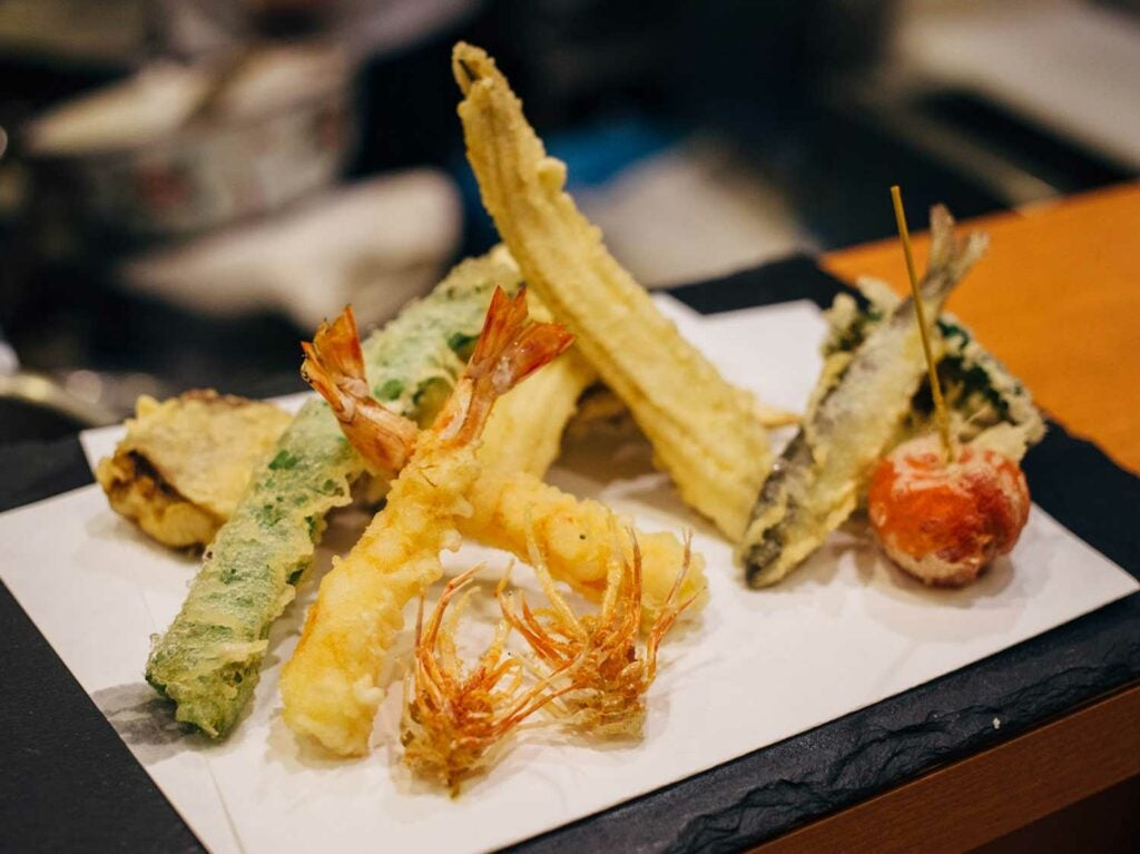 Abe Honten's early summer tempura includes ayu (sweetfish), cherry tomato, flat beans, and baby corn.