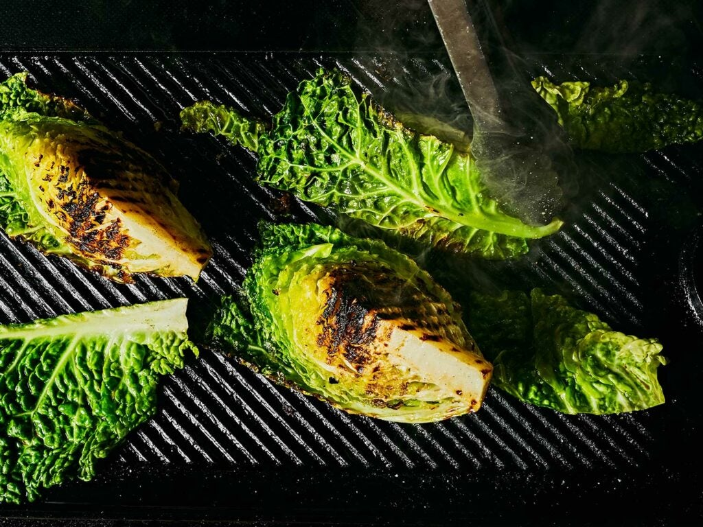 Hot cast-iron grill pan chars cabbage.