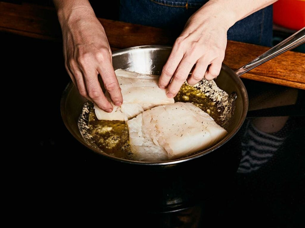 Searing cod in a mixture of olive oil and butter.