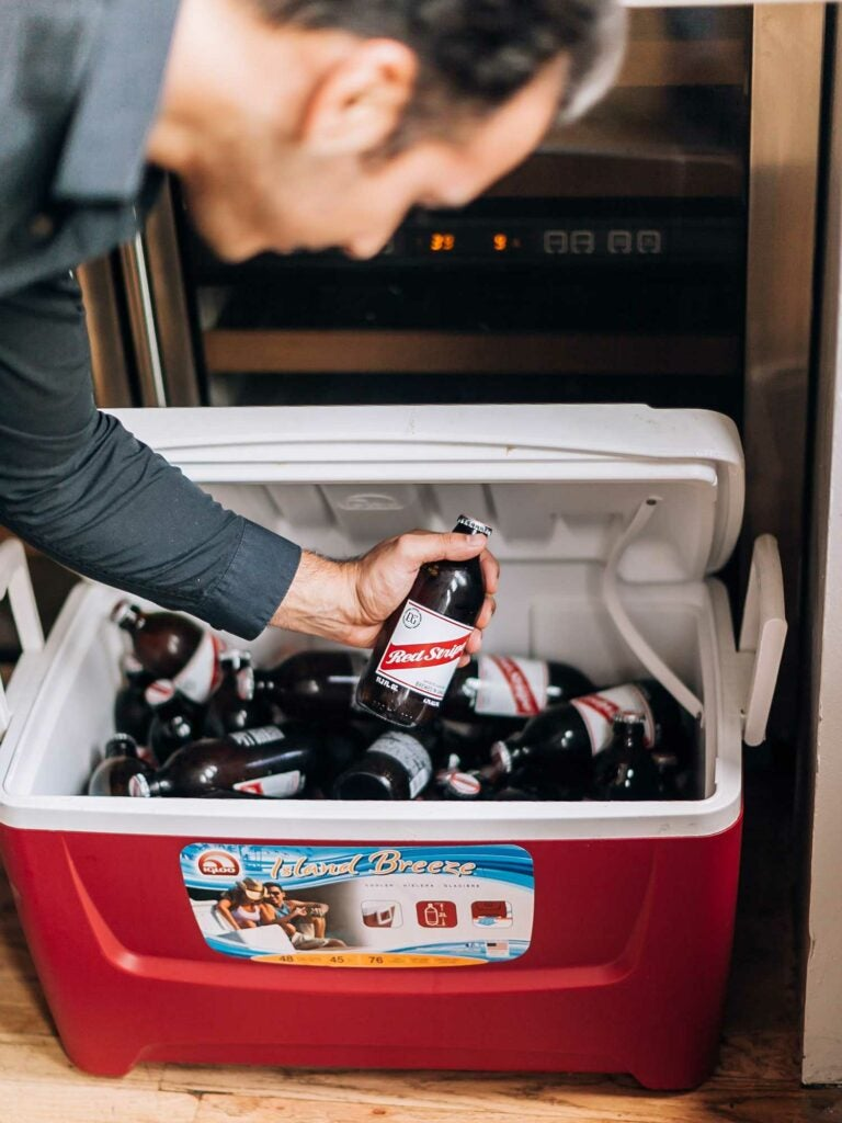 Red Stripe Jamaican lager in a red cooler.