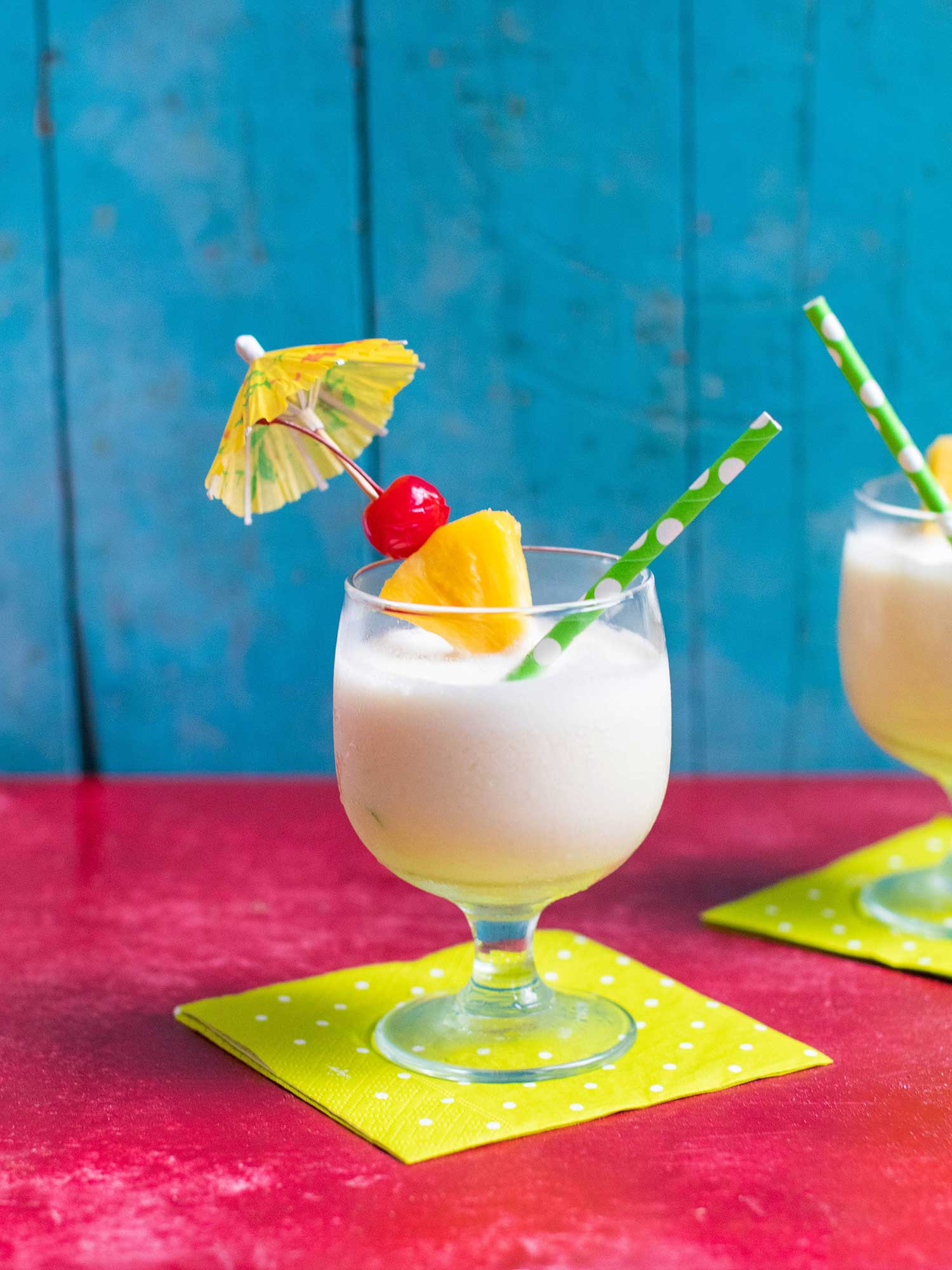 Frozen pina colada with umbrella and cherry on top