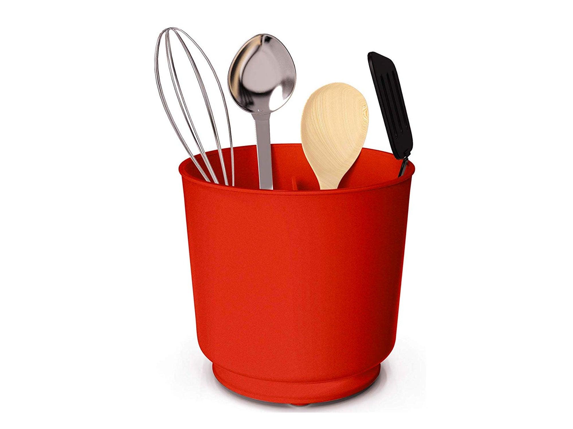 Large red utensil crock