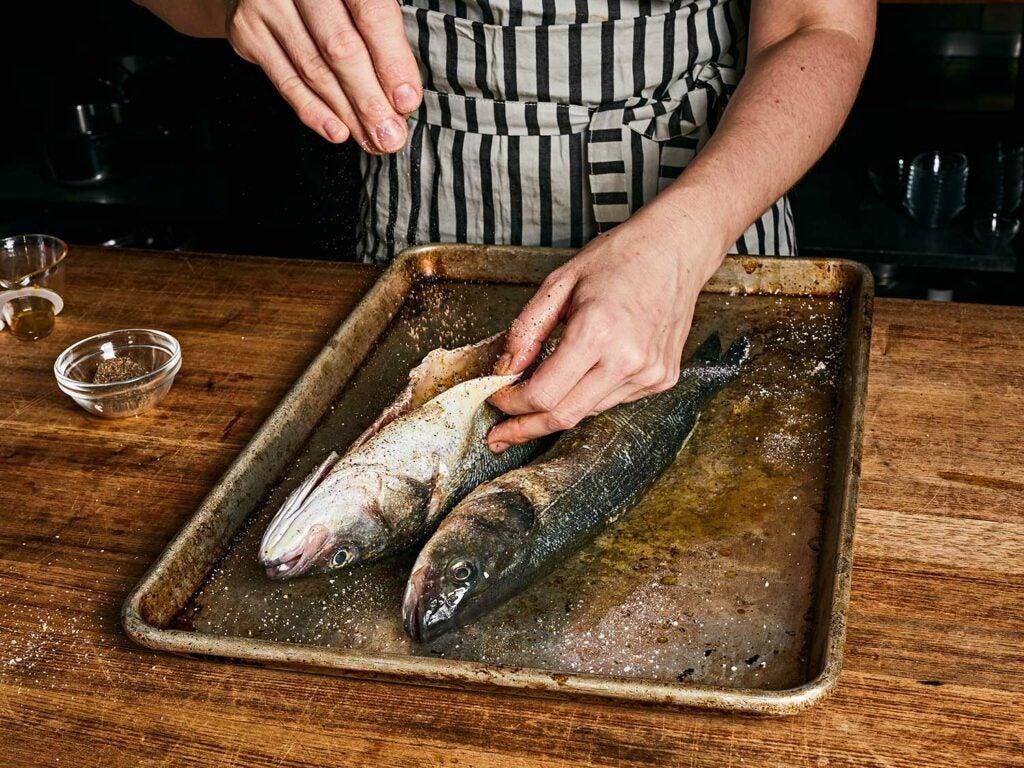 Season the cavity of the fish.