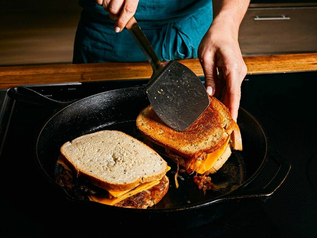 Pan searing finished sandwich in the cast-iron skillet until evenly golden.