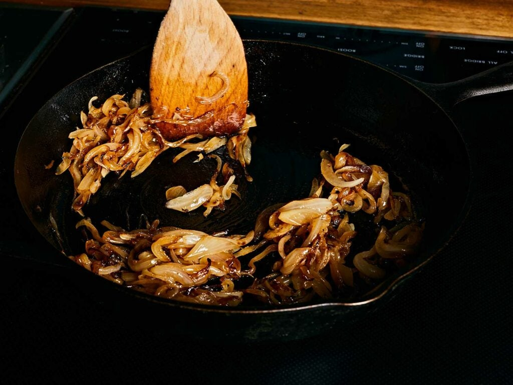 Caramelizing onions in a cast-iron skillet.