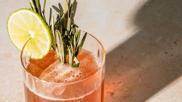 cocktail with sprig of rosemary