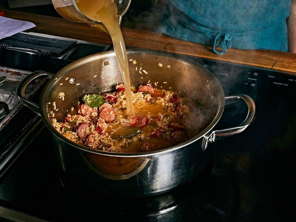 Deglazing the pot with plenty of hot chicken broth.