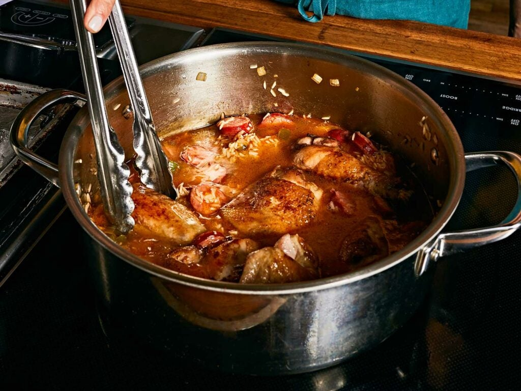 Simmering chicken in pot.