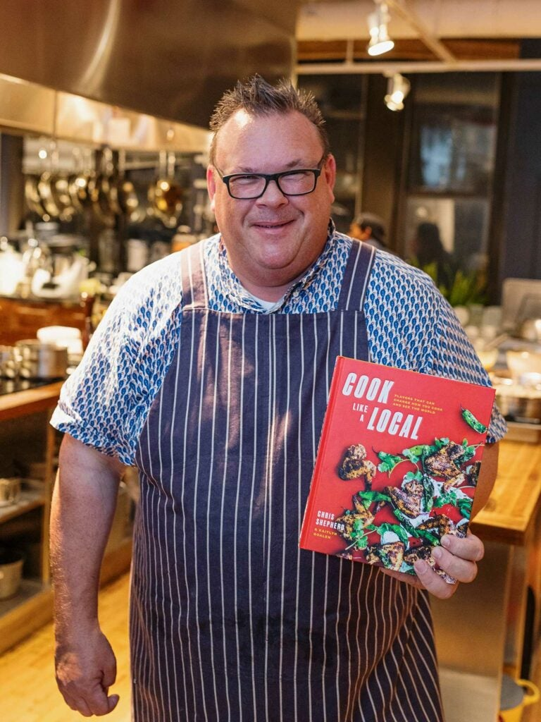Chef Chris Shepherd with his new book, Cook Like a Local, in the SAVEUR test kitchen.