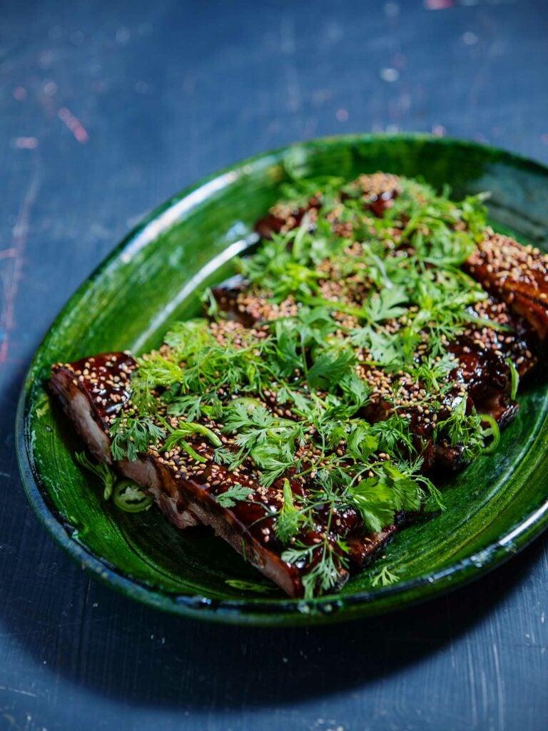 Cosme chef Estefania Brito's riff on Shepherd's ribs marinated with sriracha, palm sugar, serrano chiles, cilantro, green onions, and sesame seeds.