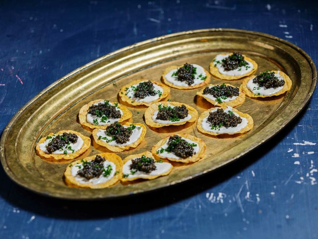 Tostadas with Keluga caviar from Regalis Foods, crema, and chives.