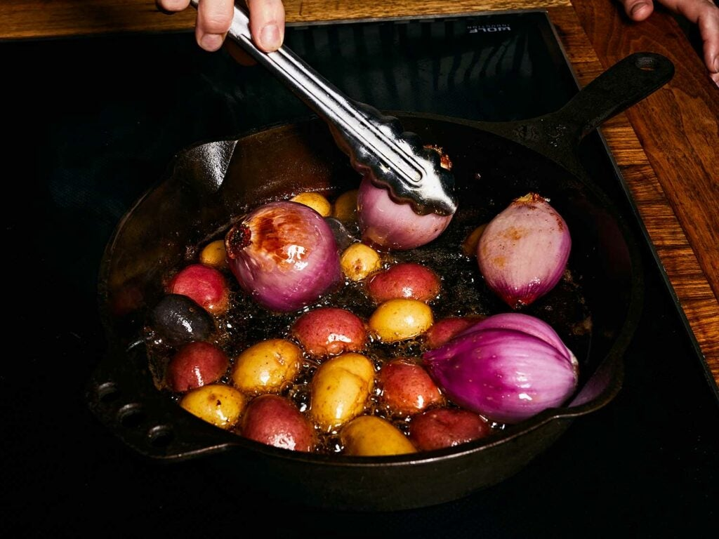 Browning potatoes and shallots to add more flavor to the finished stew.
