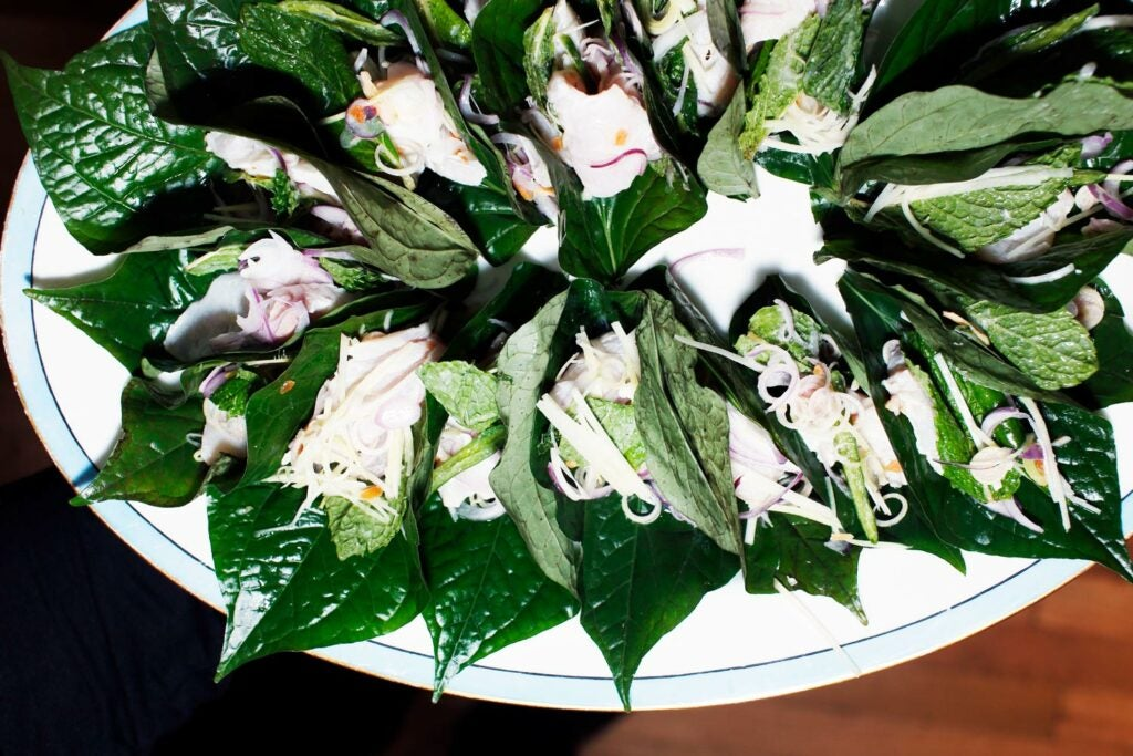 cured kingfish wrapped in betel leaves