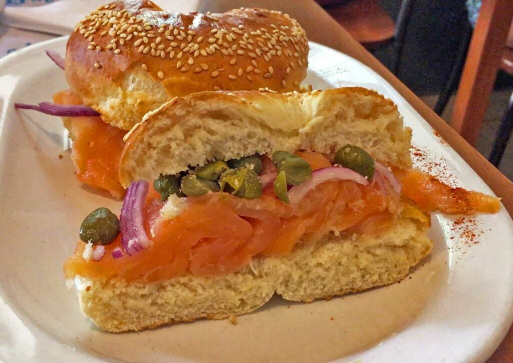 A sesame bagel with lox and cream cheese at La Crespo in Buenos Aires.