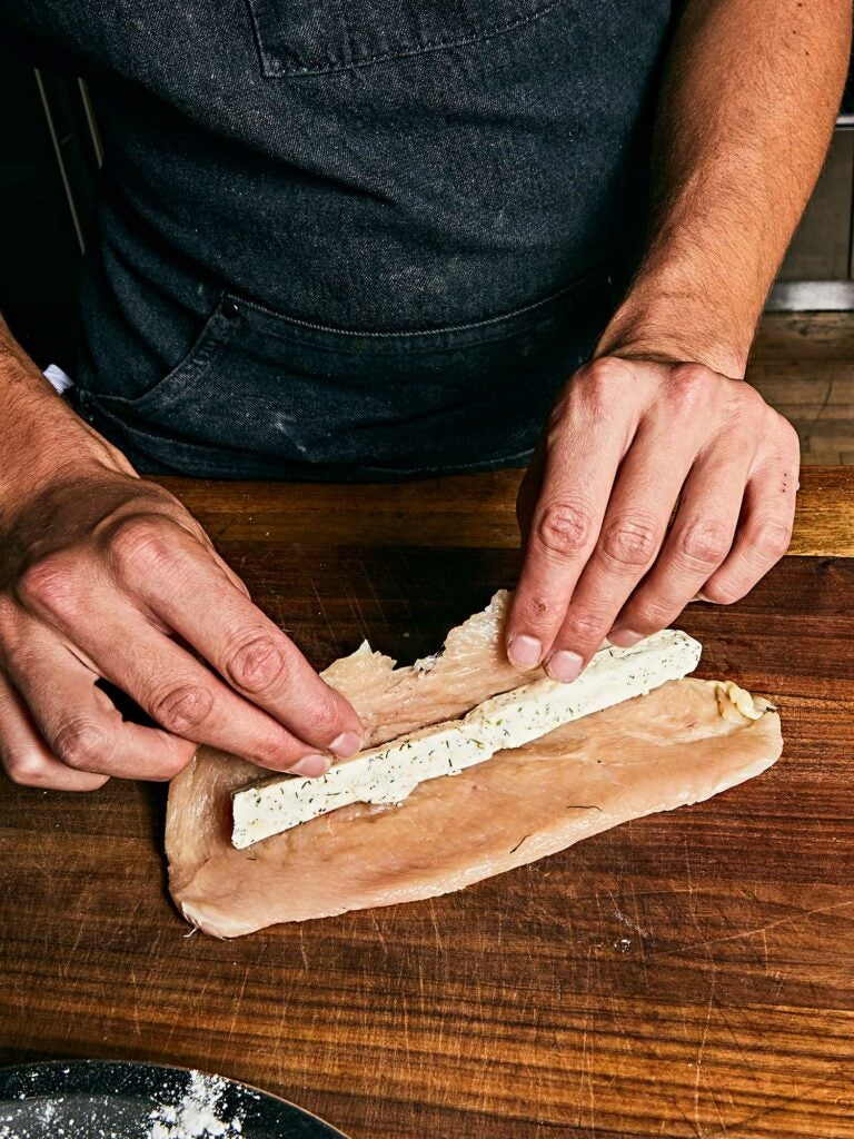 A thin log of compound butter rolled up inside the chicken cutlet.