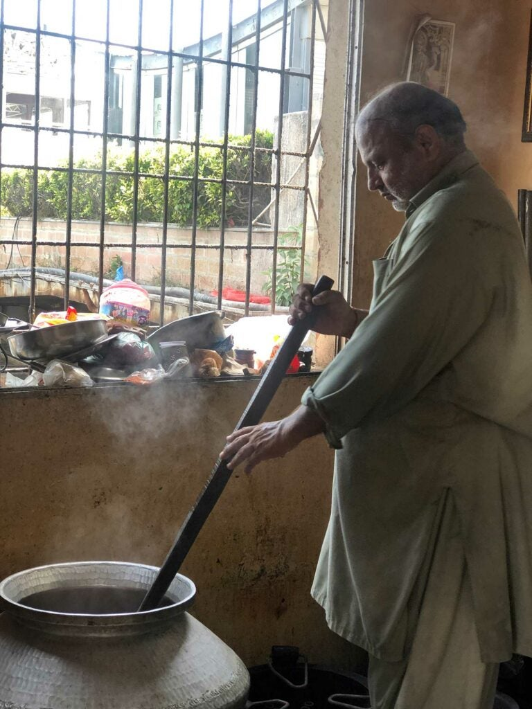 Maharaj starts to cook the vegetable biryani.
