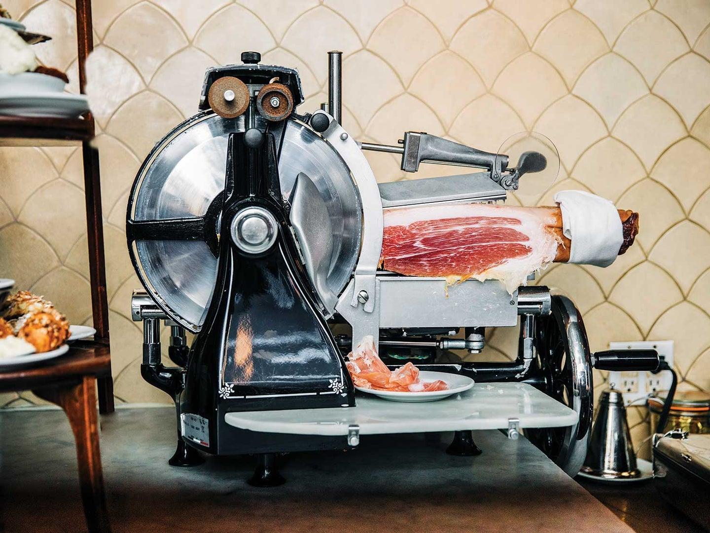 Classic Berkel meat slicer sits behind the bar at Manhattan restaurant Buvette.