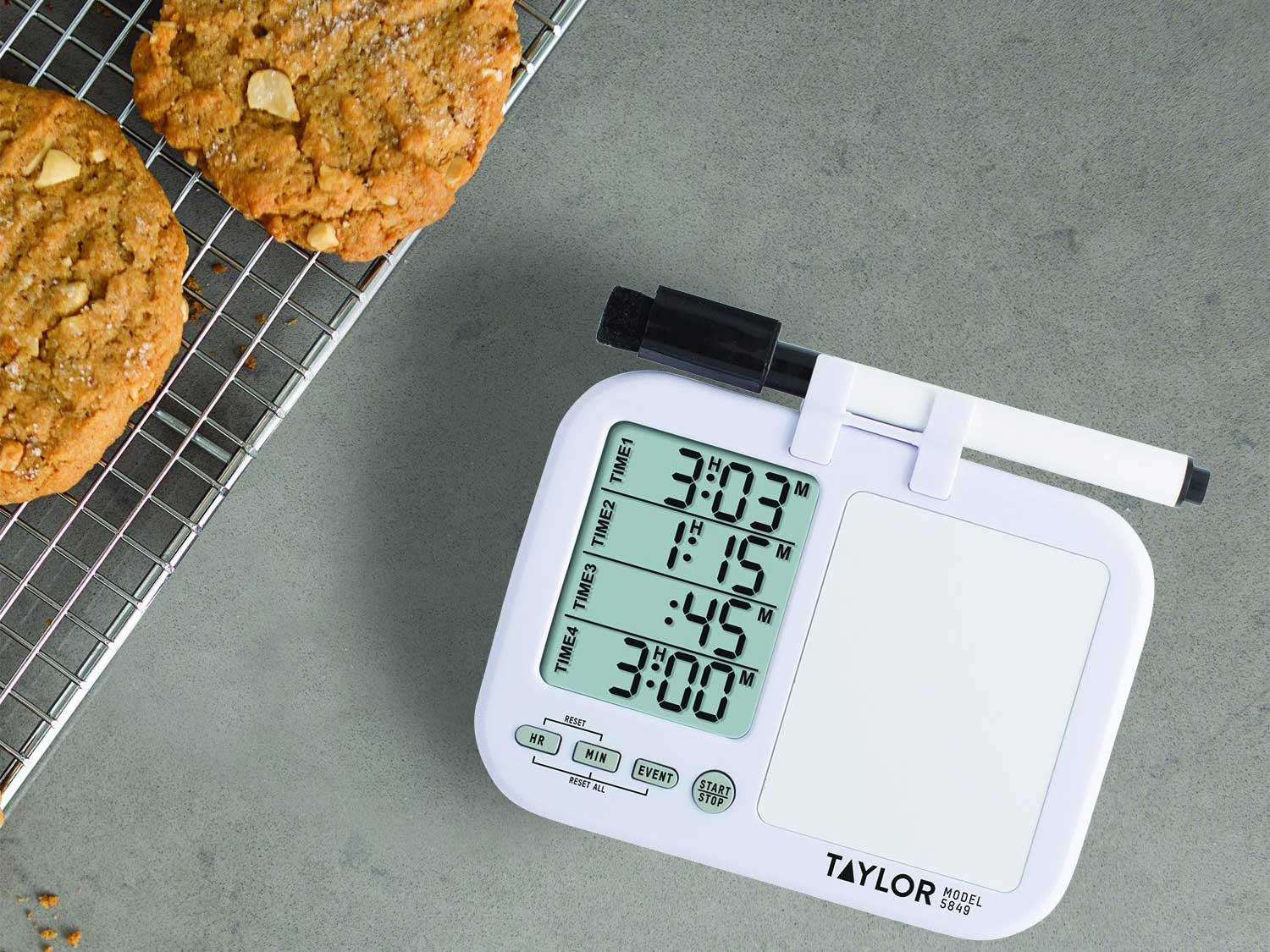 Kitchen timer and cookies on cooling rack.
