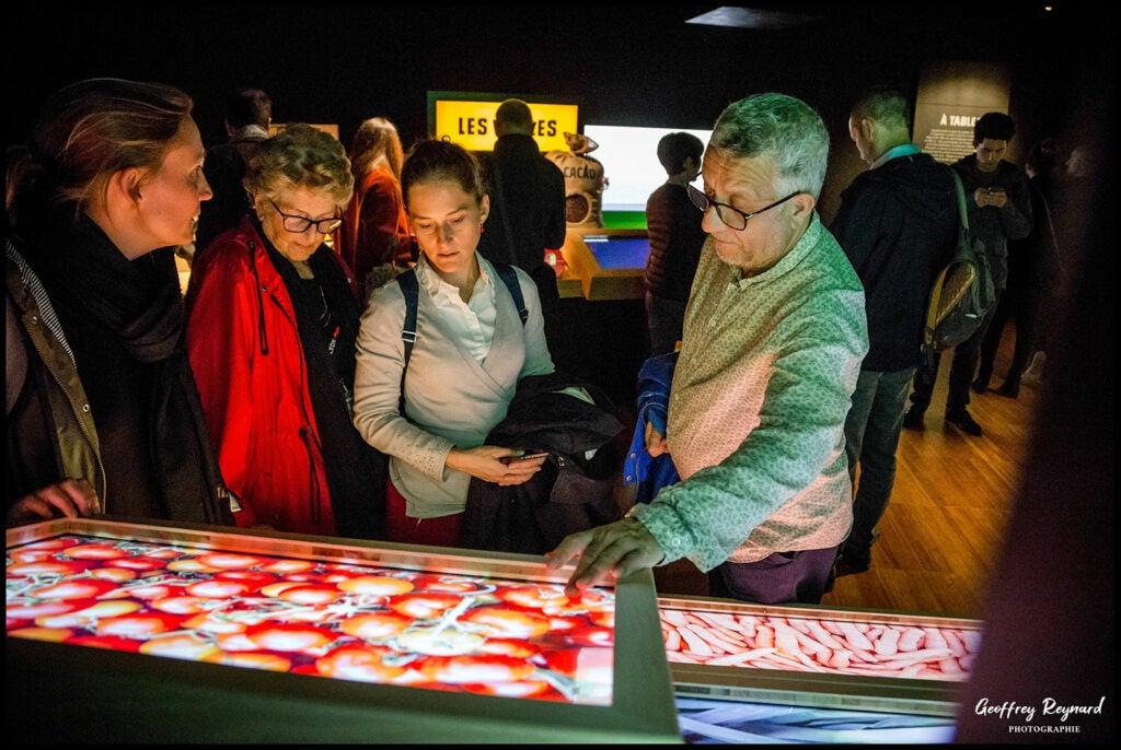Guests visit interactive touchscreen exhibit at Lyon's New 'Cité Internationale de la Gastronomie'.