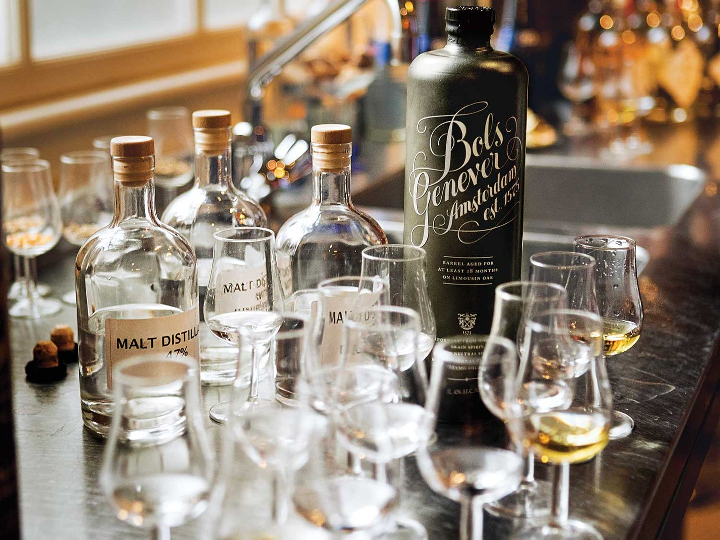 A bottle of Bols genever sits amid base spirits at the 355-year-old Amsterdam distillery.