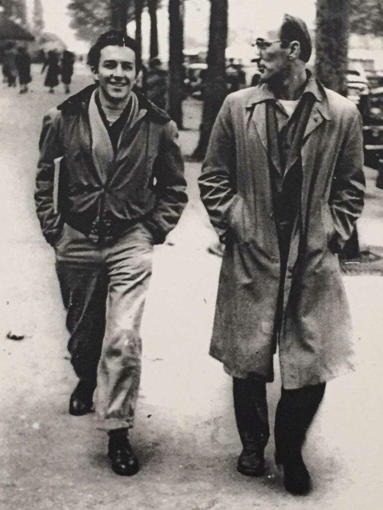 Mitchell walks the Boulevard de Montparnasse with his friend, character actor Frank Billerbeck.
