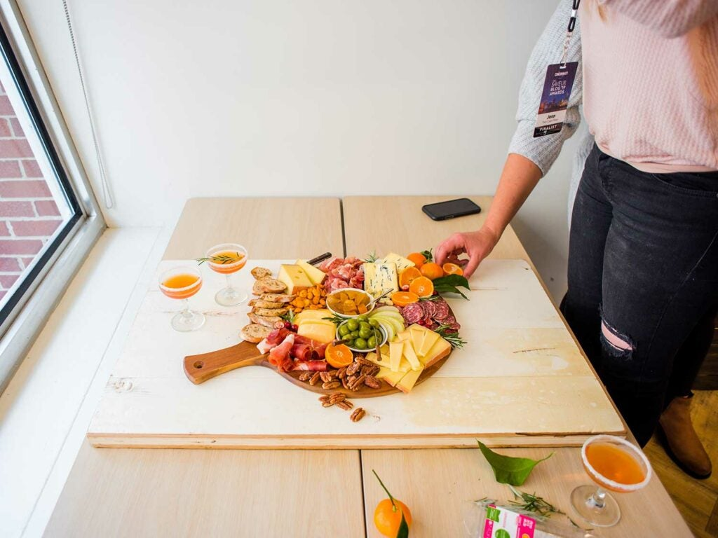 As part of a hands-on workshop at Kroger's new Innovation Center, bloggers assembled their ultimate cheese-and-charcuterie plates featuring products from Murray's Cheese, the Manhattan specialty cheese and meat shop that was purchased by Kroger in 2017.