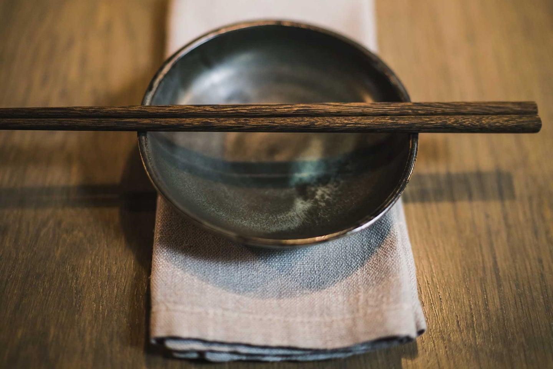 Cloth napkin with black bowl and chopsticks