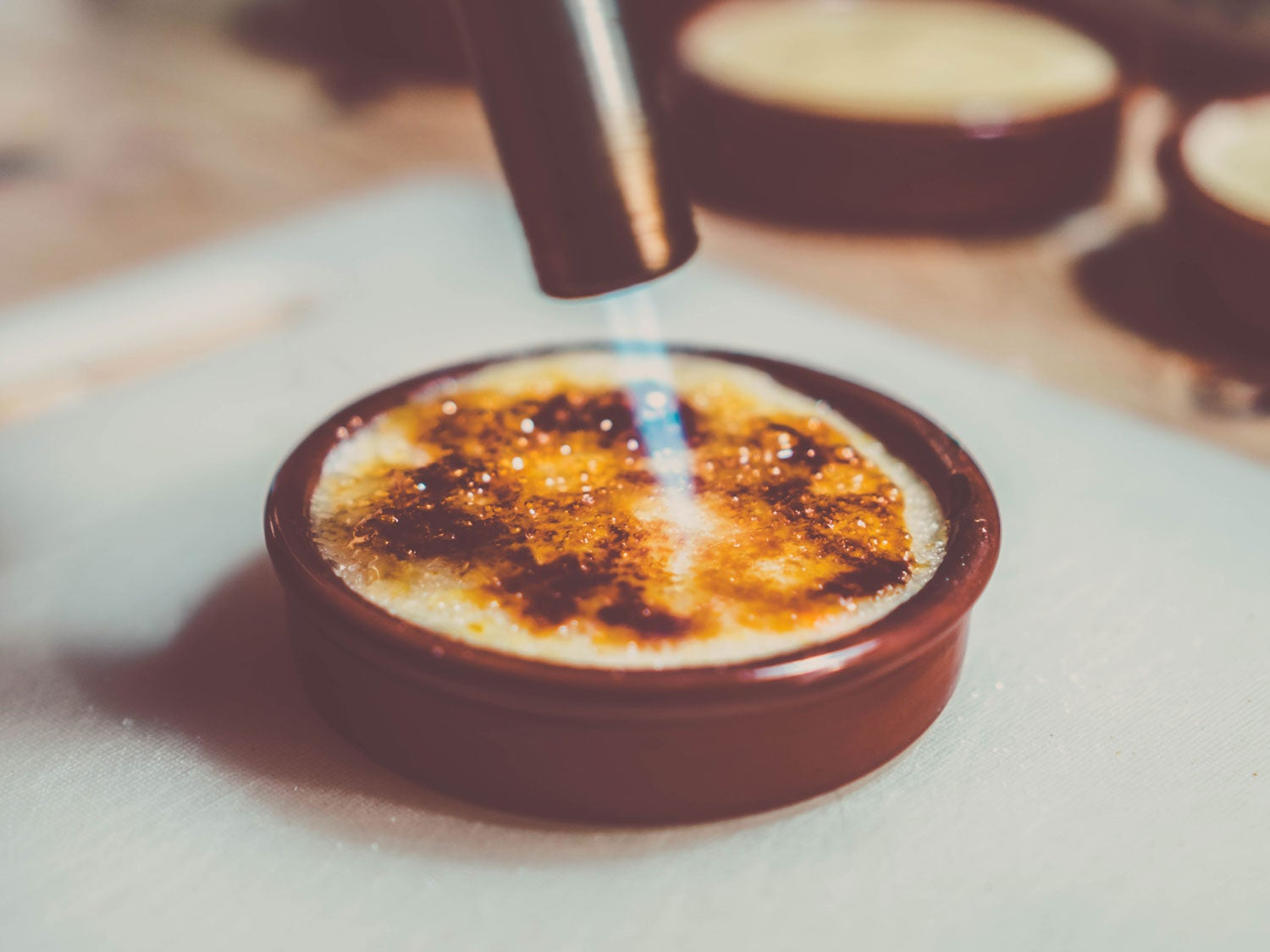 Using blow torch on creme brulee