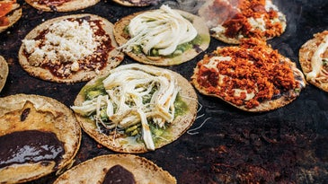 Memelas, sope-like snacks particular to Oaxaca, cook on the comal at Memelas Doña Mago.