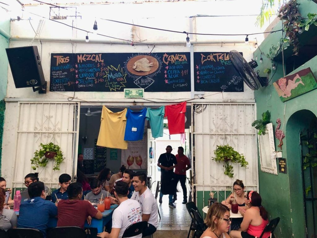 Cantina La Negrita's colorful back patio is family-friendly and lively.