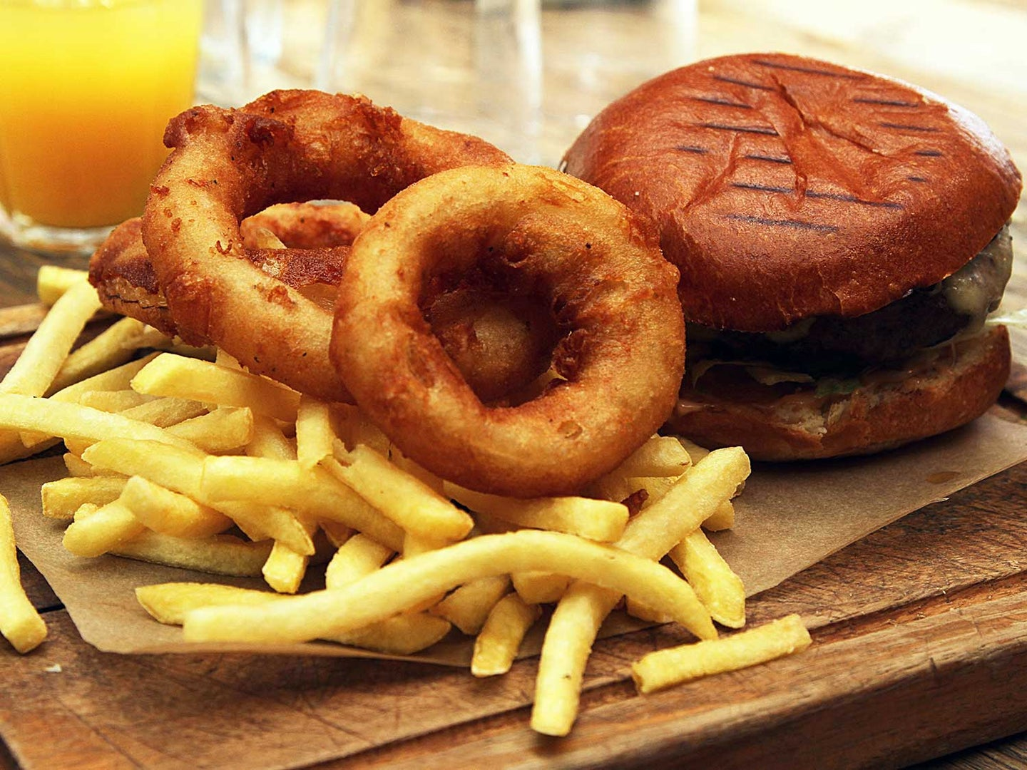 Burgers, fries, and onions rings