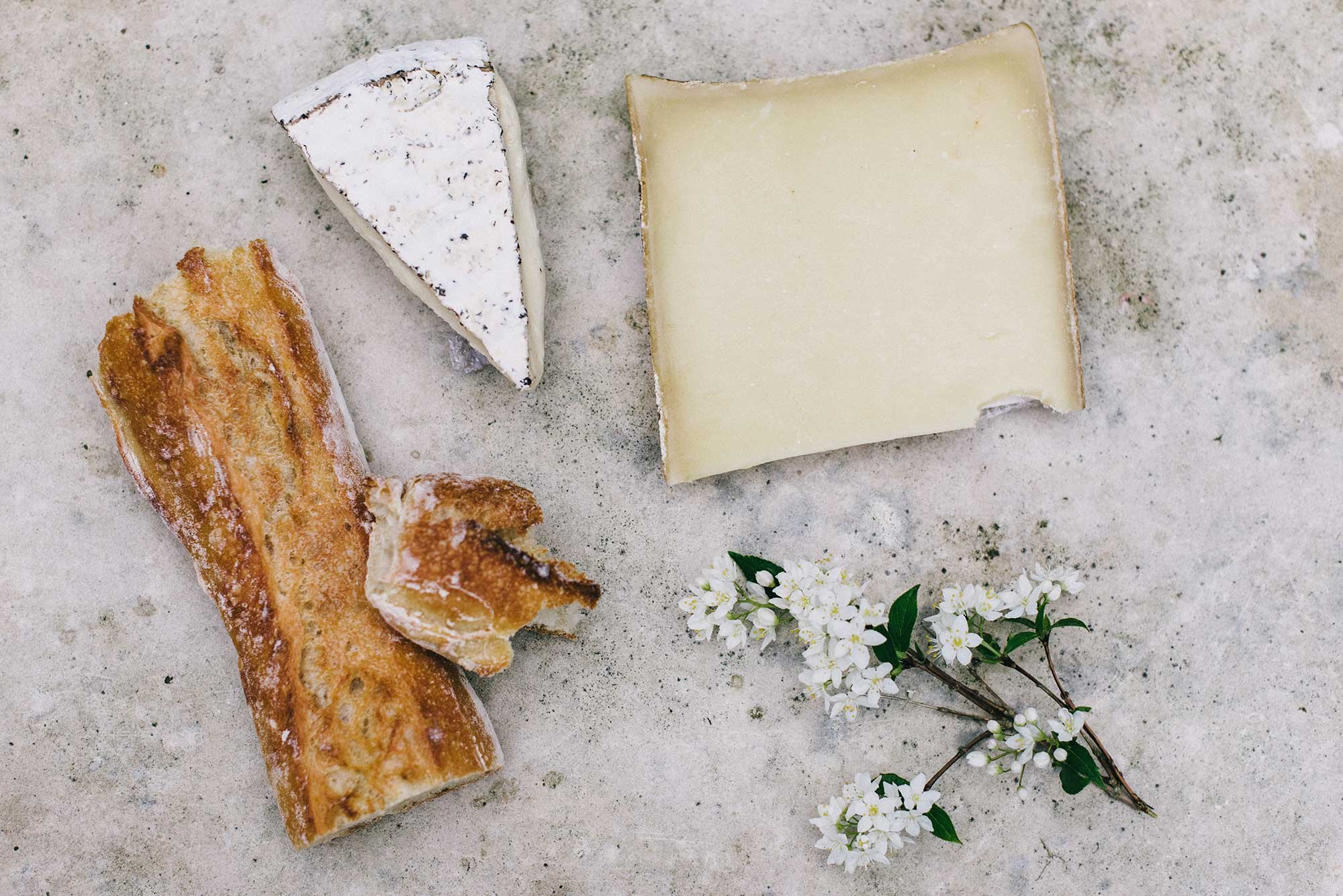 Beautiful cheeses and a crusty loaf of bread