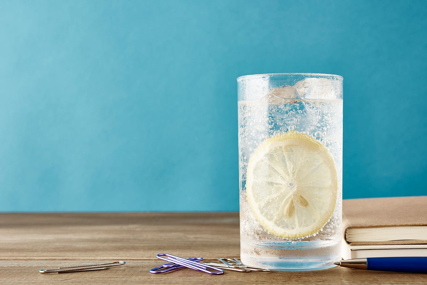Glass of sparkling water with lemon slice