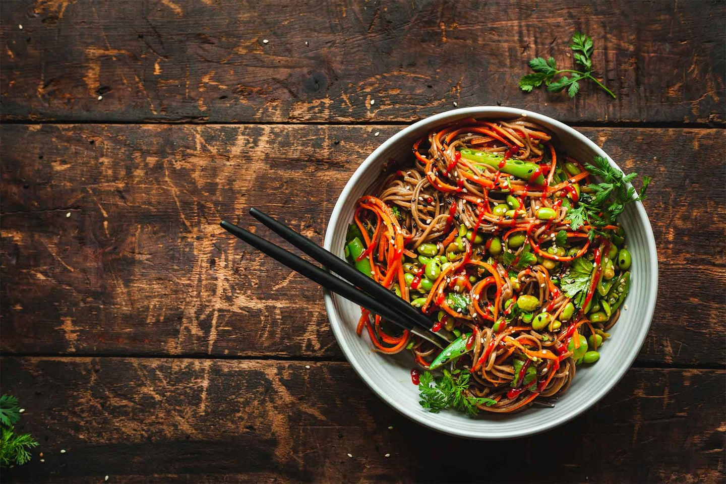 Bowl of noodles and vegetables with chopsticks
