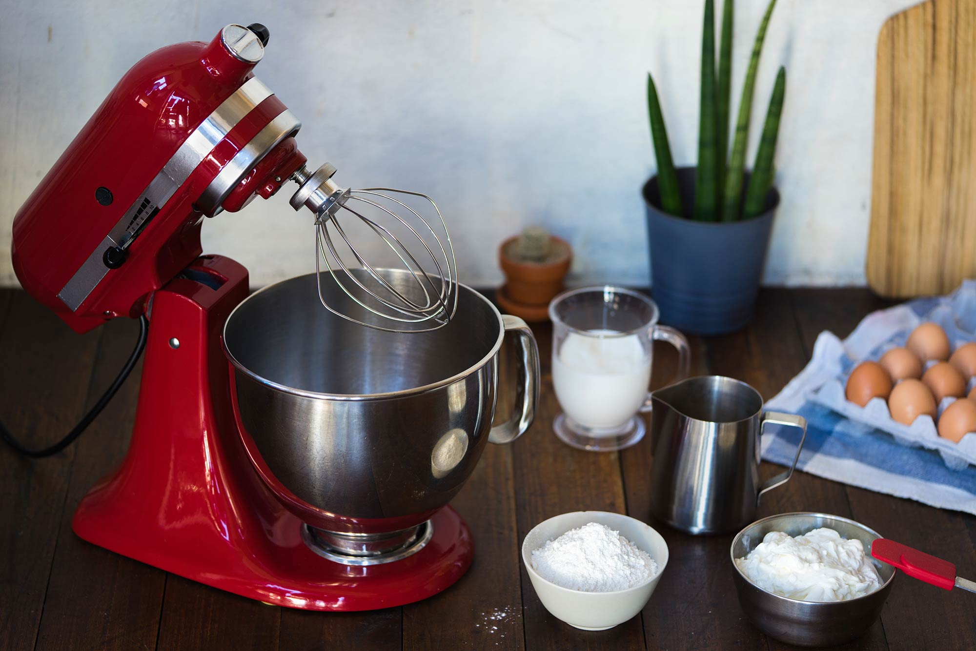 Red stand mixer on a countertop