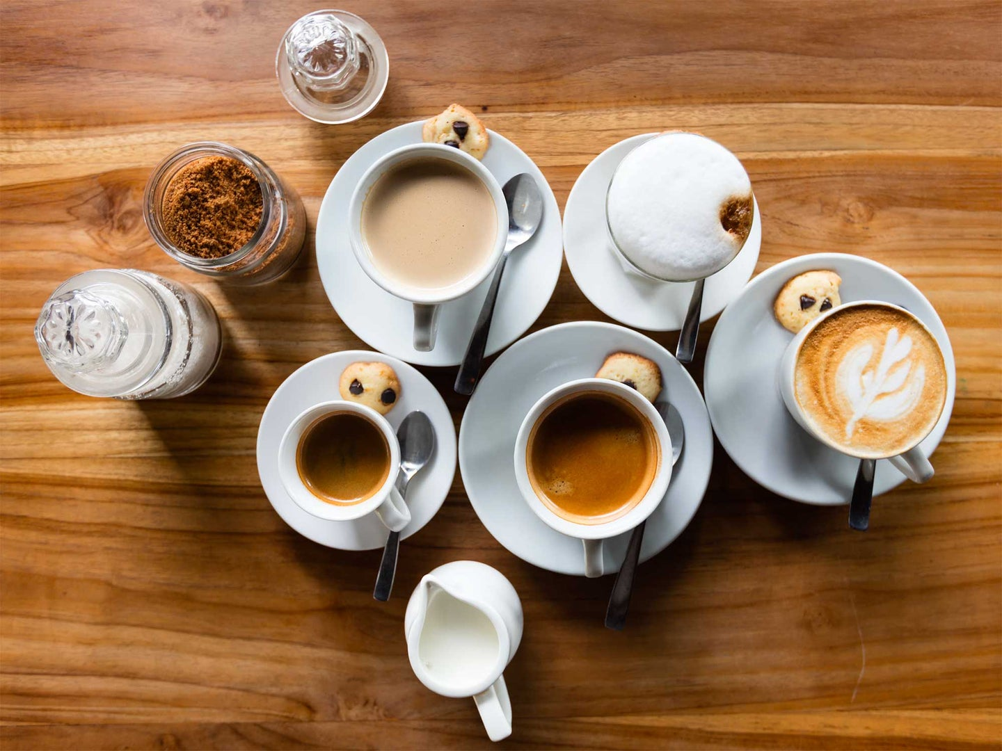 Cups of coffee on a wooden table