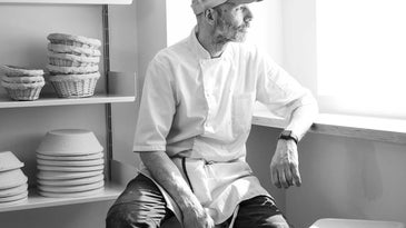 The bakery's owner, Norman Jean Roy, in a rare moment of repose.