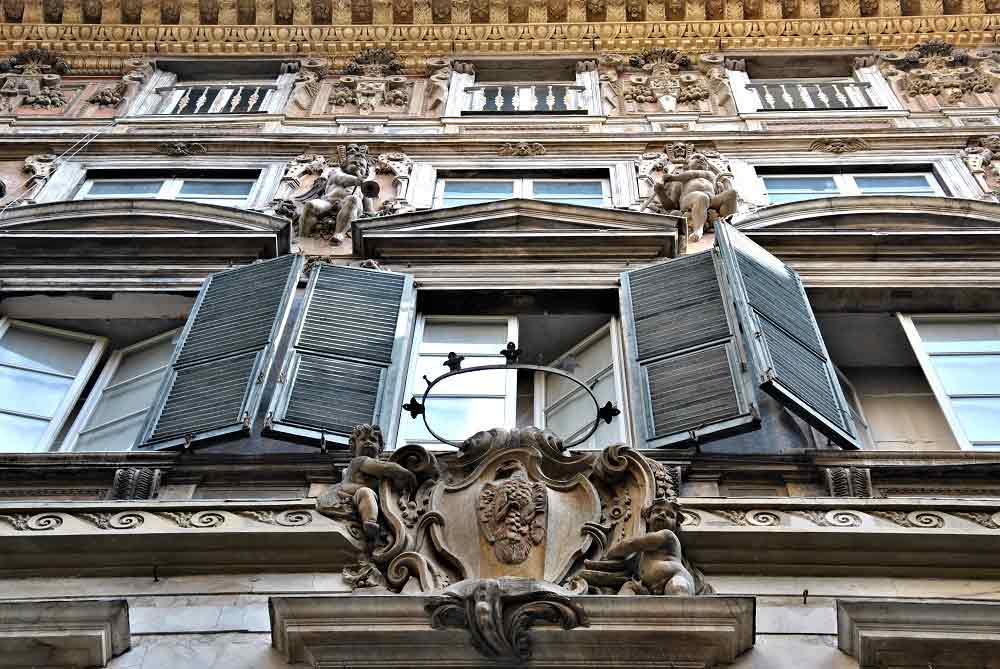 Grand palace façades line Genoa's old center.