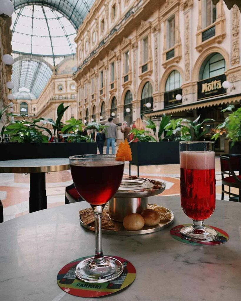 An aperitivo can be enjoyed indoors or on a piazza outdoors.