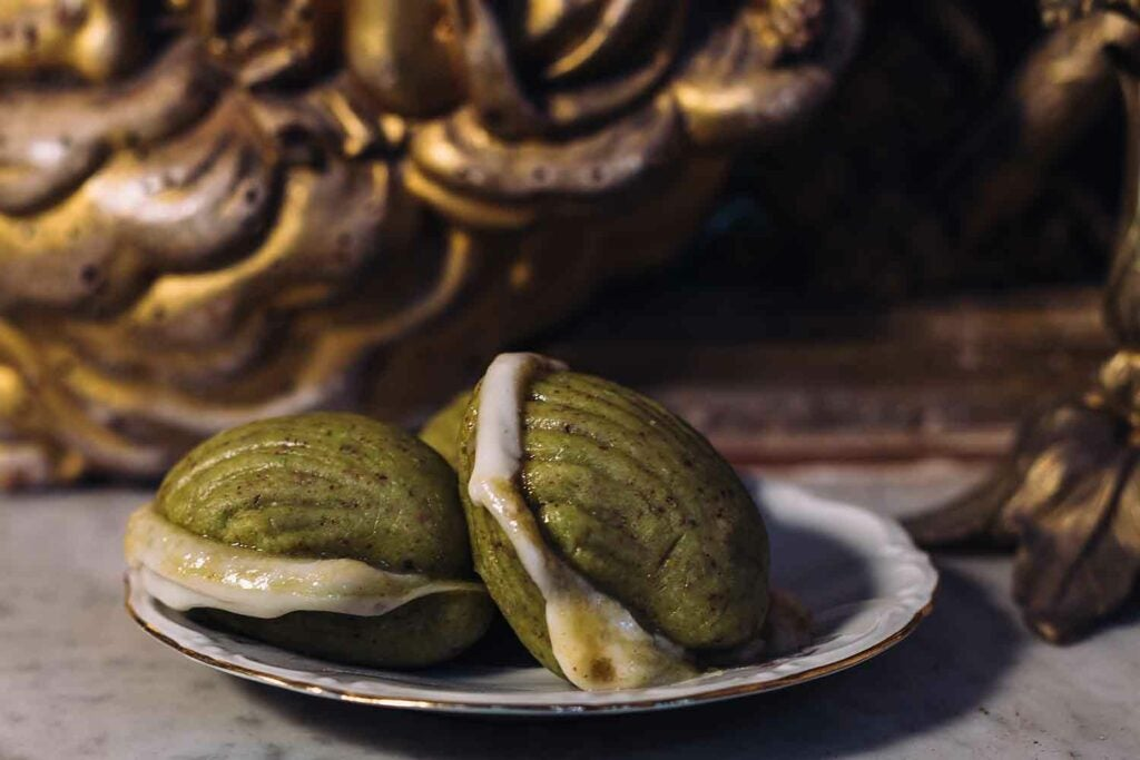 Fedde del cancelliere are made with pistachio almond paste, apricot jam, and cream.