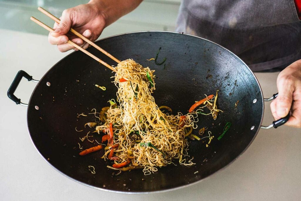 Add the vermicelli with the vegetables and sauce ingredients and stir-fry until the noodles are dry and cooked through.
