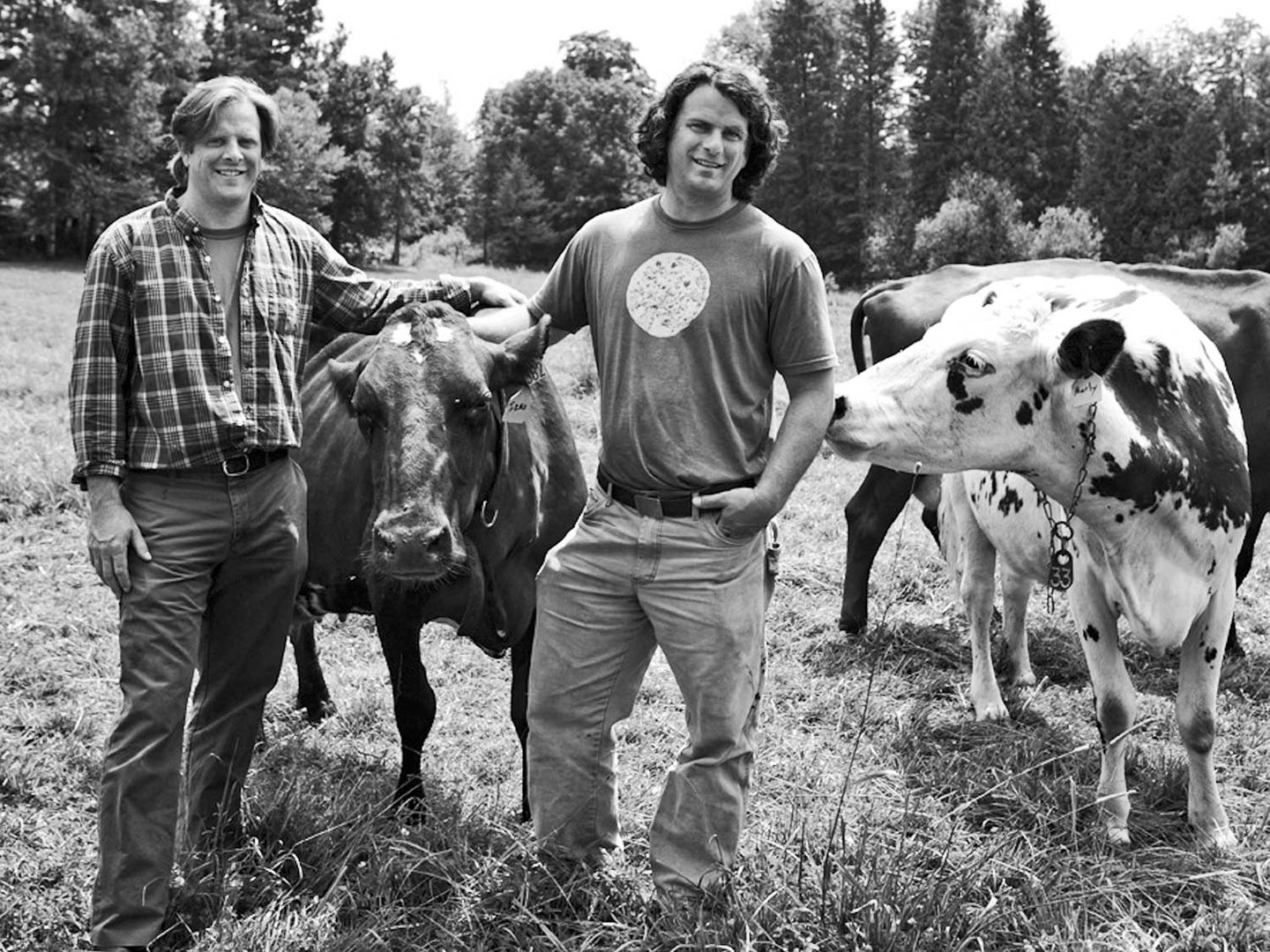 Andy (left) and Mateo Kehler pose with a few of their Ayrshire cows at Jasper Hill Farm in Greensboro, Vermont.